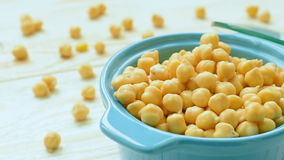 Chickpea in vintage clay bowl. On the wooden table stock footage