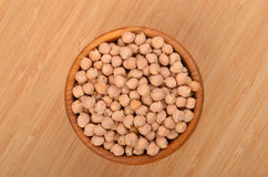 Chickpea in wooden bowl Stock Images