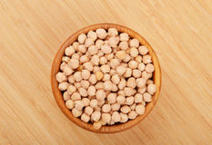 Chickpea in wooden bowl Royalty Free Stock Photo