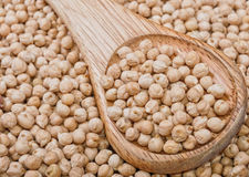 Chickpea with wooden spoon Royalty Free Stock Photography