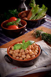 Chickpeas. Traditional Italian dish with basil Stock Photography