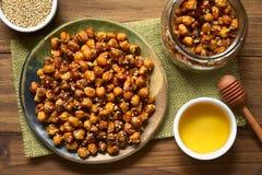 Ψημένα Chickpeas με το σουσάμι και το μέλι Στοκ Εικόνα