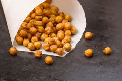 Chickpeas baked with spices closeup on black metal background with place for text Stock Photo