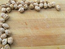 Chickpeas boarder on wooden background Royalty Free Stock Image