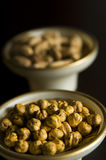 Chickpeas on the bowl and pistacio Royalty Free Stock Photo