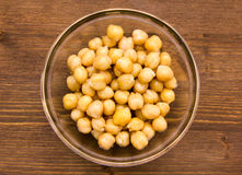 Chickpeas on bowl on wood Royalty Free Stock Image