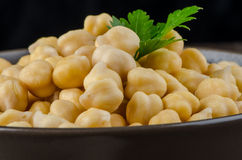 Chickpeas in a brown bowl Royalty Free Stock Photos