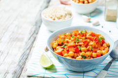 Chickpeas carrots pepper coconut milk curry with brown rice Stock Photography