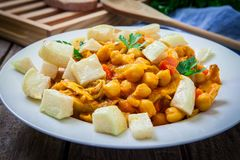 Chickpeas with chicken. And vegetables on plate Royalty Free Stock Image