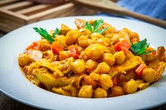 Chickpeas with chicken. And vegetables on plate Stock Photo