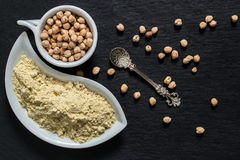 Chickpeas and chickpea flour on the surface of the shale Royalty Free Stock Photo