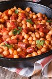 Chickpeas with chorizo and vegetables in tomato sauce Royalty Free Stock Image