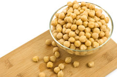 Chickpeas in glass dish Stock Images