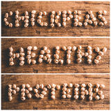Chickpeas healthy proteins. Mosaic of written on wooden background - chickpeas healthy proteins royalty free stock photos