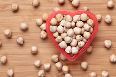 Chickpeas in a heart bowl Stock Images