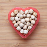 Chickpeas in a heart bowl Stock Image