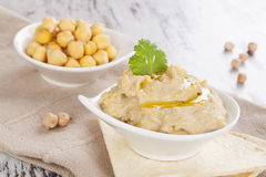Chickpeas and hummus. Stock Photography