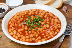 Chickpeas In Tomato Sauce With Fresh Herbs Stock Photos