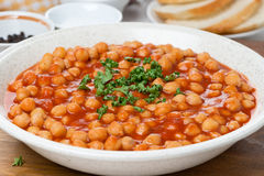 Chickpeas In Tomato Sauce With Herbs, Closeup Royalty Free Stock Images