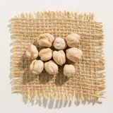 Chickpeas legume. Close up of grains over burlap. Cicer arietinum is scientific name of Chickpeas legume. Also known as Garbanzo bean, Chick Peas or Grao de Royalty Free Stock Images