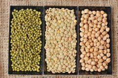 Chickpeas, lentils, mung beans in black plate on the gunny cloth Stock Photo