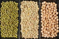 Chickpeas, lentils and mung beans in black plate Stock Image