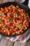 Chickpeas with meat in tomato sauce in the pan vertical Royalty Free Stock Photo