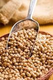 Chickpeas in metal scoop Stock Photos