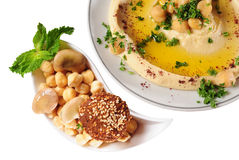 Hummus. Isolated. Chickpeas with olive oil and falafel Stock Images