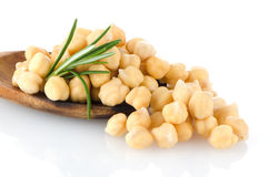Chickpeas over wooden spoon Stock Images