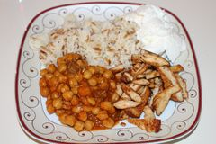 Chickpeas, rice, yoghurt and grilled chicken. Traditional turkish food. Grilled chicken breast cut into strips. Delicious turkish food Stock Photos