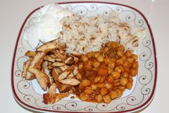 Chickpeas, rice, yoghurt and grilled chicken. Traditional turkish food. Grilled chicken breast cut into strips. Delicious turkish food Stock Photo