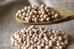 Chickpeas. On sackcloth with spoon Stock Photo