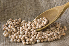 Chickpeas on sackcloth. With spoon Stock Photos