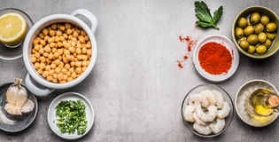 Chickpeas salad ingredients in bowl on gray concrete background, top view Royalty Free Stock Photo