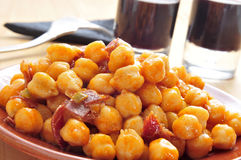 Chickpeas with serrano ham Stock Images
