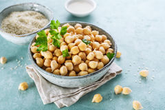 Chickpeas, sesame seeds and oil. Ingredients for cooking hummus. Chickpeas, sesame seeds and oil royalty free stock photos