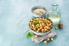 Chickpeas, sesame seeds and oil. Ingredients for cooking hummus. Chickpeas, sesame seeds and oil. Food background with copy space for your text stock photography