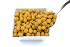 Chickpeas in small white dish. Chickpeas in a small white bowl. High resolution color image Royalty Free Stock Images