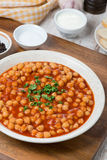 Chickpeas Stewed In Tomato Sauce On A Plate, Vertical Stock Photo