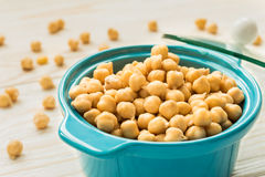 Chickpeas in turquoise ceramic pot Stock Photos