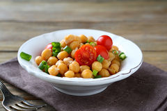 Chickpeas with vegetables in a bowl Stock Images