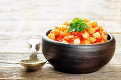 Chickpeas with vegetables and pangasius Stock Images