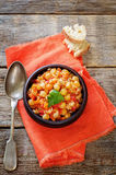 Chickpeas with vegetables and pangasius Stock Image