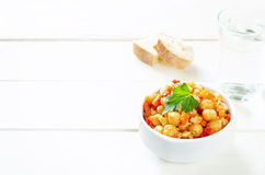 Chickpeas with vegetables and pangasius Stock Photos