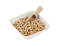 Chickpeas in white bowl with wooden shovel Stock Photography
