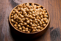 Chickpeas on wood bowl Stock Images