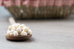 Chickpeas on a wood spoon. Some chickpeas on a wooed spoon in a wooden table royalty free stock images