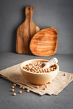 Chickpeas in a wooden bowl on gray background Stock Photography