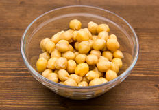 Chickpeas on wooden bowl on top Royalty Free Stock Images